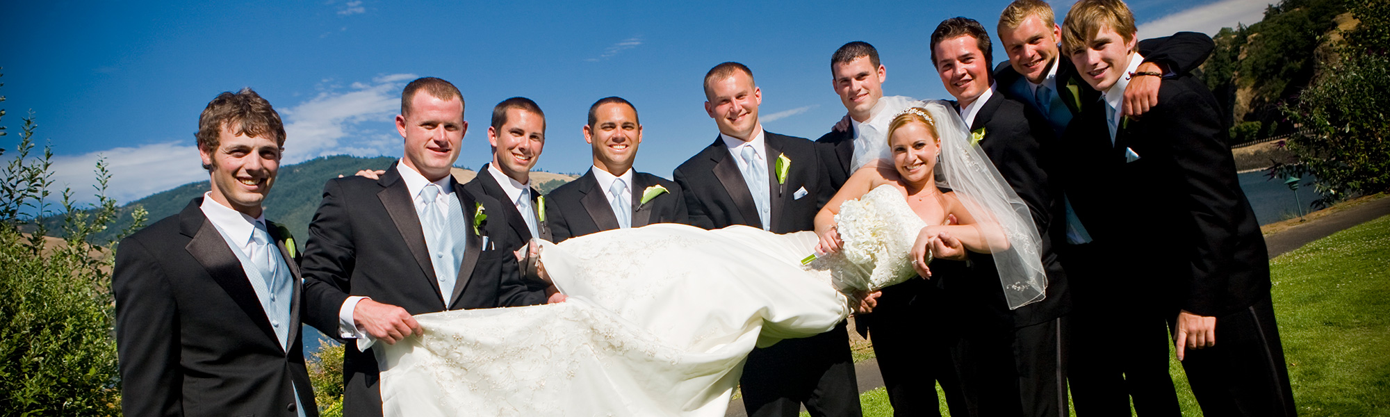 groomsman holding bride